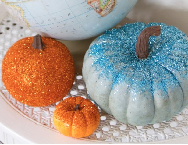 Orange and blue glitter pumpkins; a Halloween craft for kids