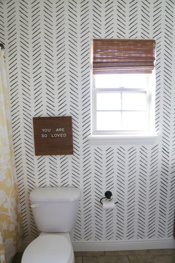 Hand drawn chevron bathroom stencil on a white wall
