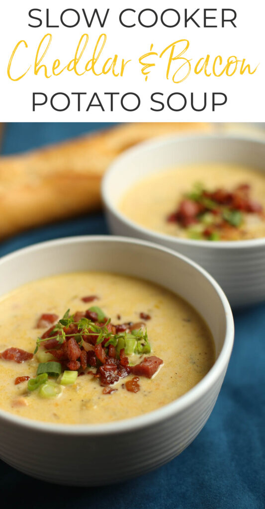 Slow Cooker Cheddar and Bacon Potato Soup in white bowls with bread.