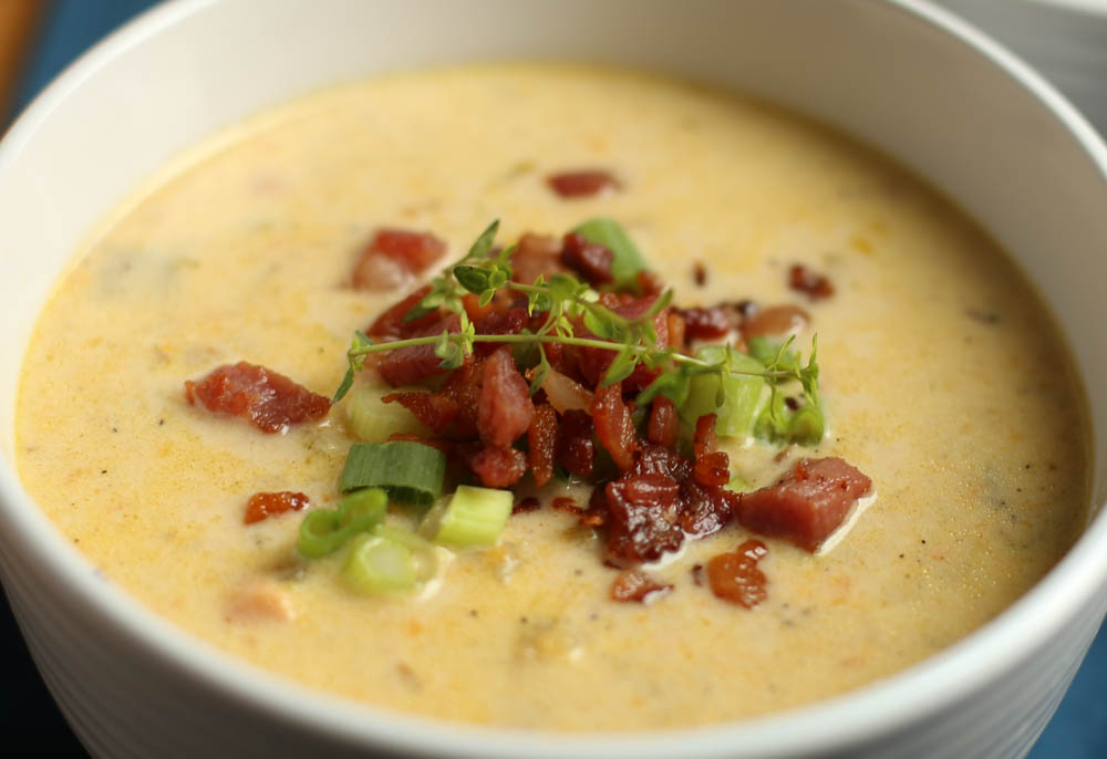 Slow Cooker Cheddar and Bacon Potato Soup in white bowl.