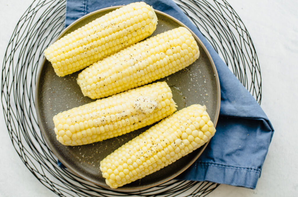 Corn on the cob after being cooked in the microwave