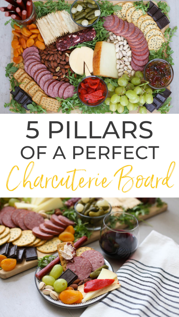 Charcuterie Board with Burgers' Smokehouse meat, cheese, crackers, grapes, apricots, pickles, roasted red peppers, pepper jelly, and dark chocolate.