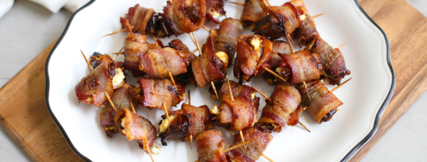 Bacon-Wrapped Dates with Goat Cheese on a plate