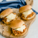 chicken parmesan sliders on a cutting board