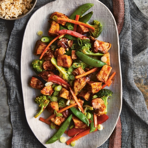 Honey Bourbon Chicken and Stir Fry Vegetables on a large white platter