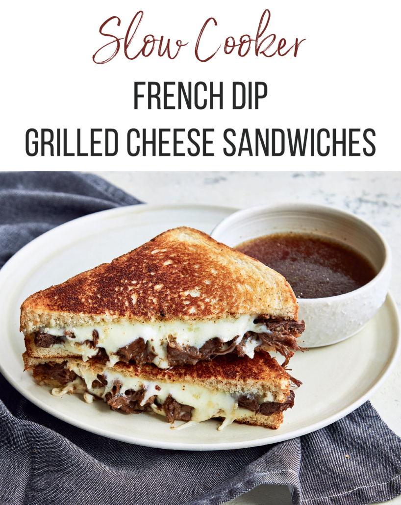 Slow cooker french dip grilled cheese sandwich on a white plate