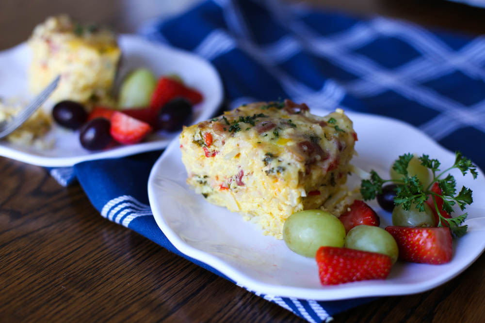 Breakfast Casserole slice on a plate with fruit