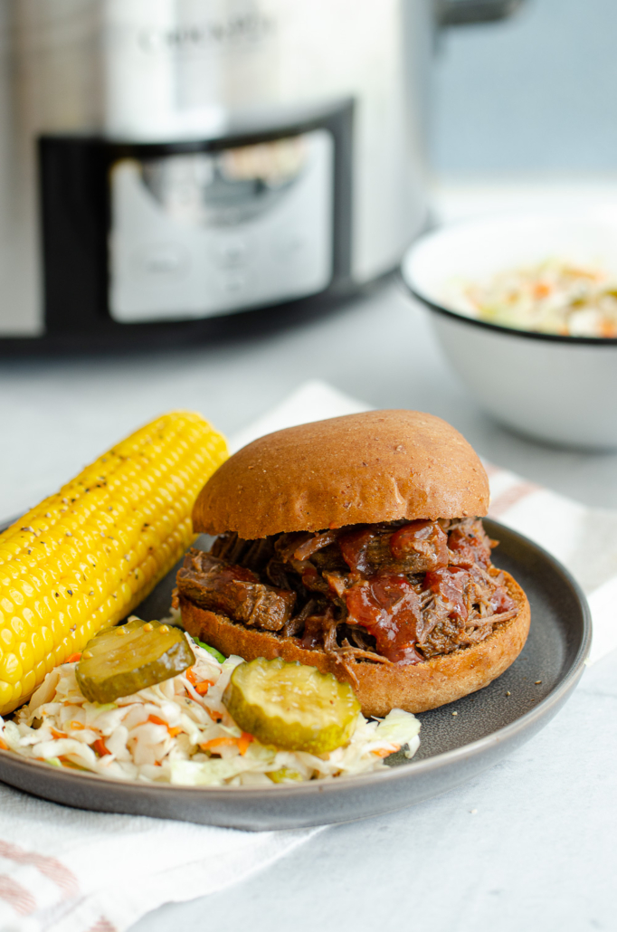 Shredded BBQ Beef Sandwich with corn on the cob