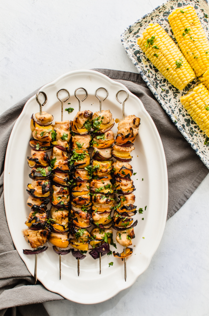 Grilled honey garlic chicken kabobs on a white plate
