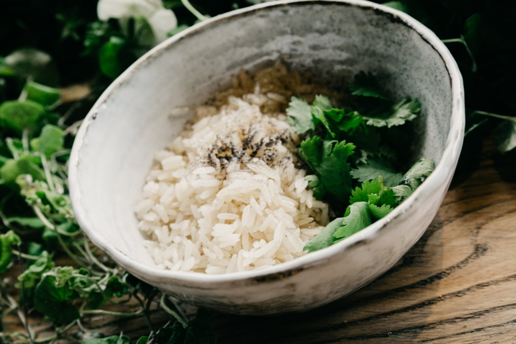 cooked rice in a bowl with cilantro