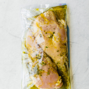 chicken breasts in freezer bag with lemon garlic marinade