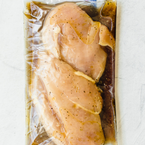 chicken breasts in marinade in a gallon sized freezer bag