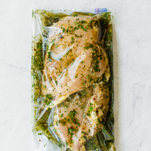 cilantro lime marinade and chicken breasts in a sealed freezer bag
