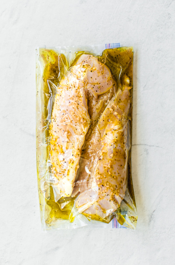 savory chicken marinade in savory chicken marinade in a freezer bag with chicken breasts