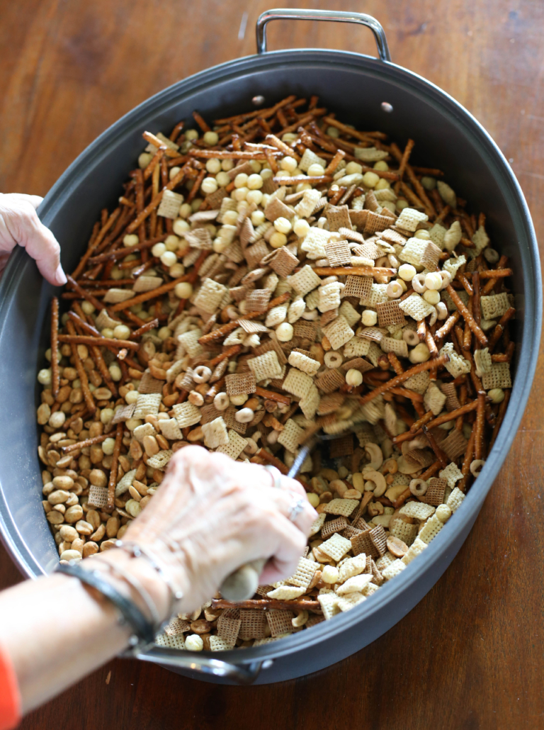 Stirring a batch of homemade chex mix