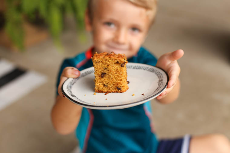 Young boy holding banana breakfast cake