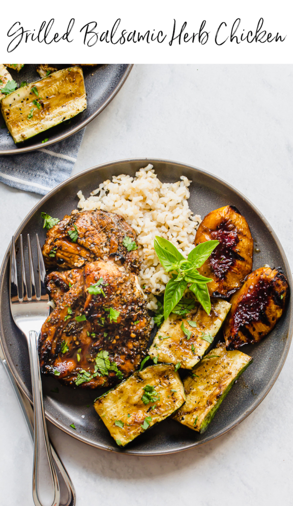 grilled chicken, rice, zucchini, and peaches on a gray plate with fork