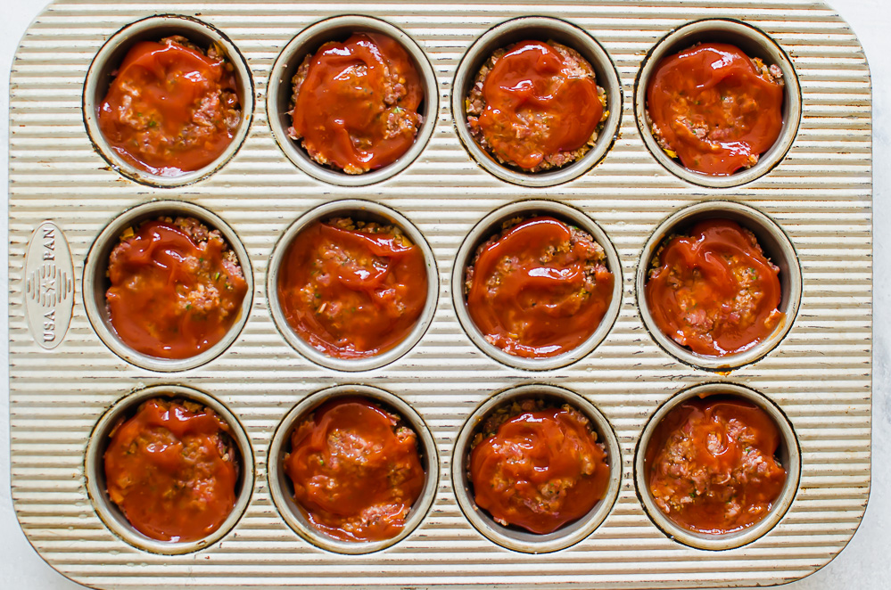 meatloaf mixture in a muffin tin