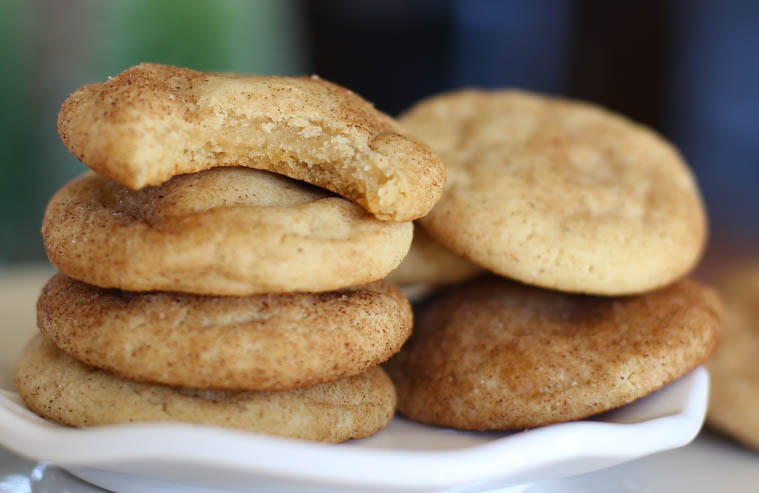 Soft and chewy snickerdoodle cookies with bite taken out