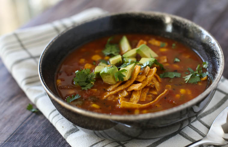 Vegetarian Tortilla Soup in a brown bowl