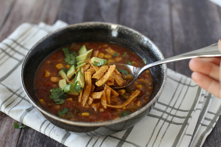 Spoon scooping instant pot tortilla soup