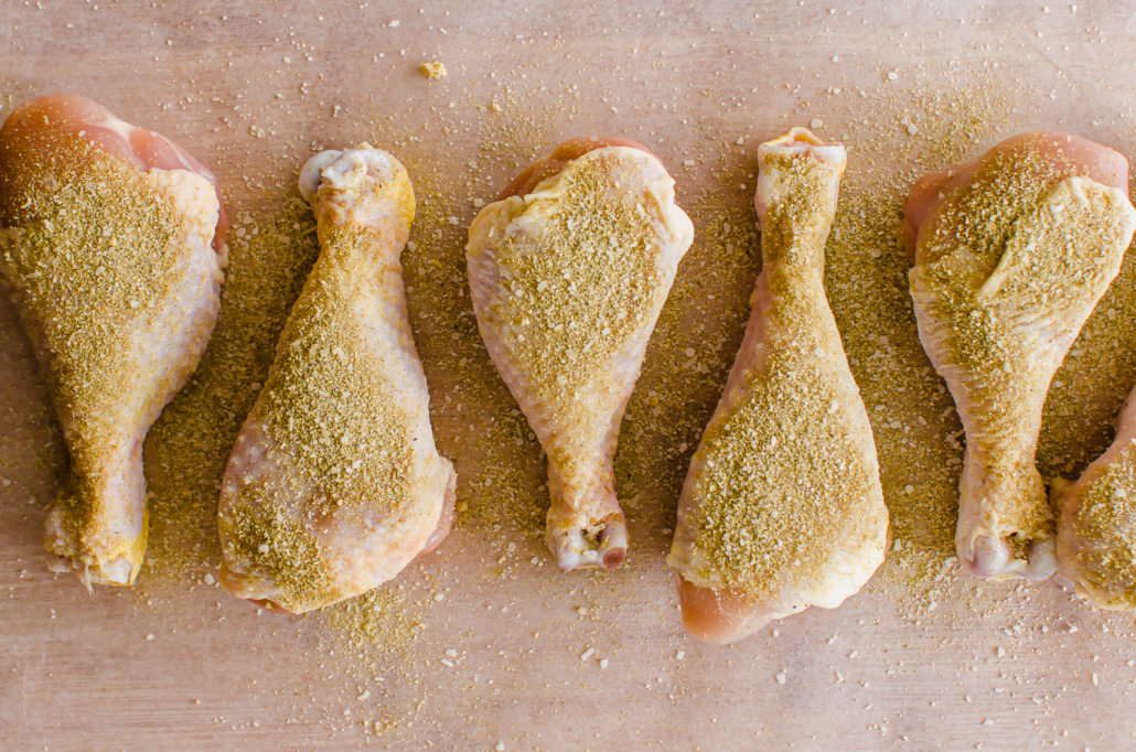seasoned chicken drumsticks on a cutting board