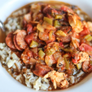 Jambalaya with chicken and andouille sausage over rice in a bowl