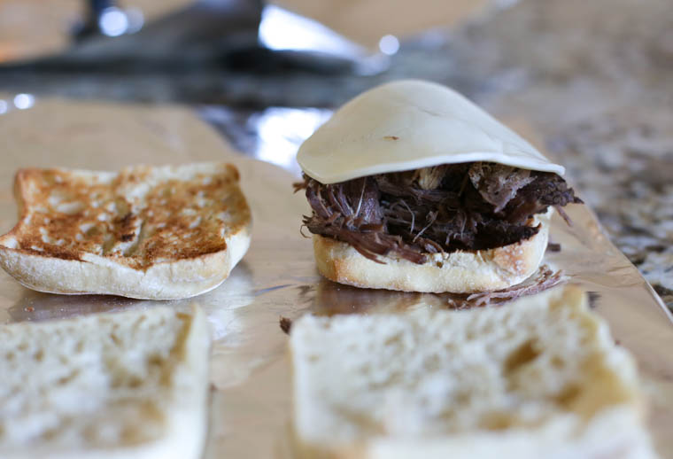 Instant Pot French Dip Sandwiches on a foil lined baking sheet