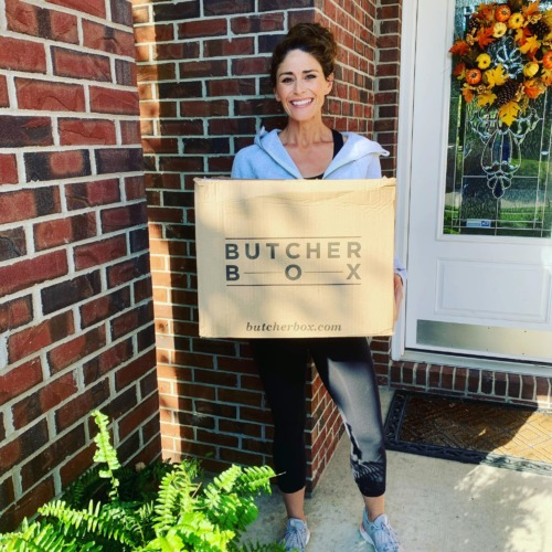 Woman holding a ButcherBox box