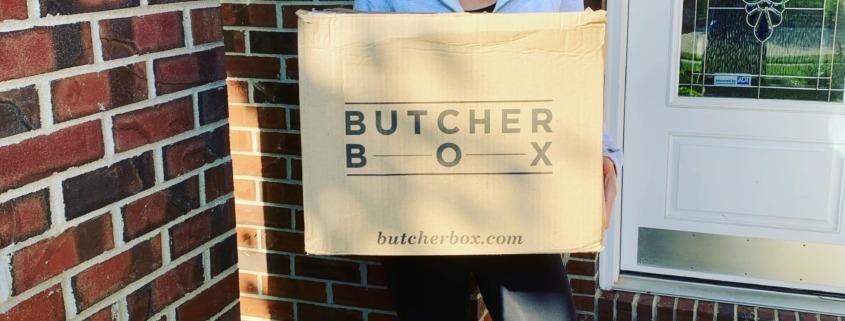 Woman holding a ButcherBox box