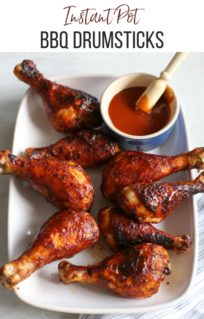 Drumsticks on a white plate with BBQ sauce