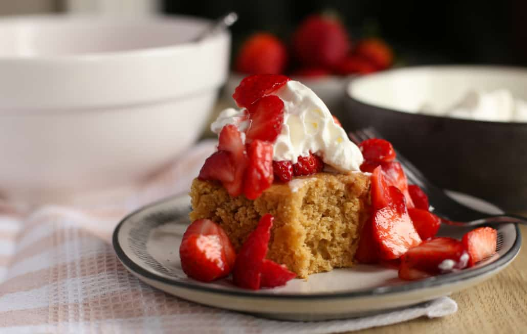 A piece of strawberry shortcake on a plate