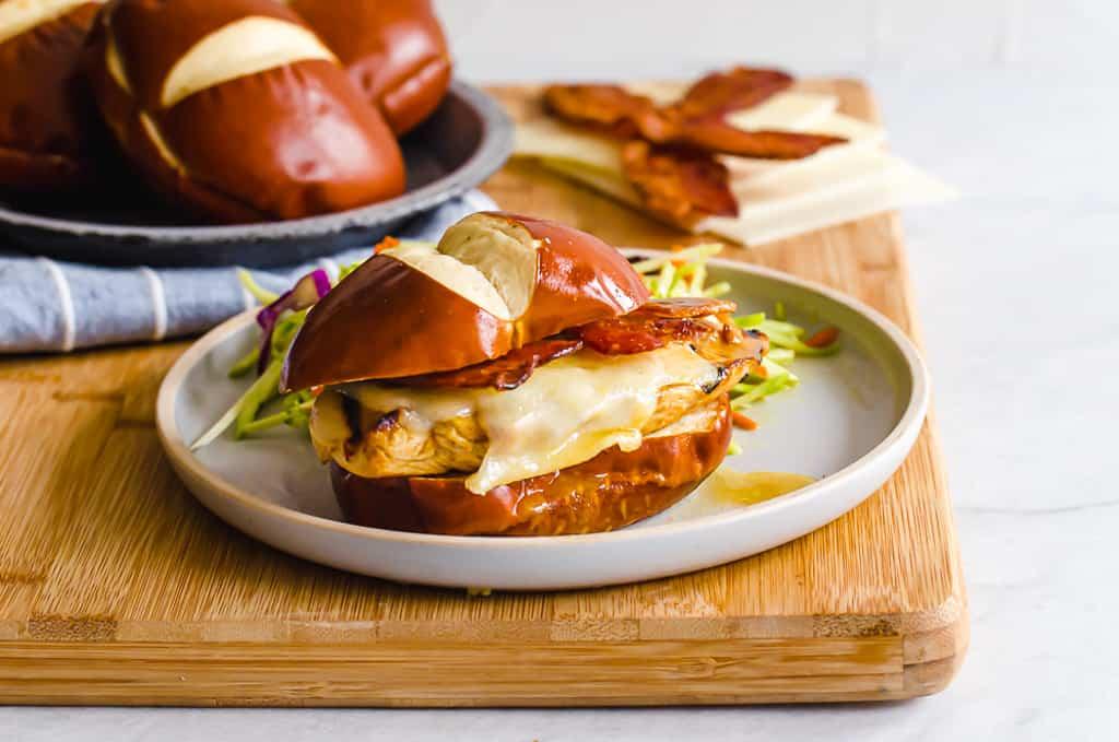 honey dijon chicken sandwich on a white plate with slaw