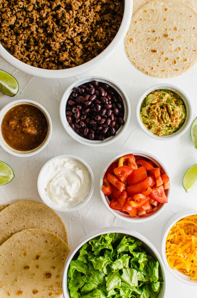 Overhead shot of ingredients for a taco bar