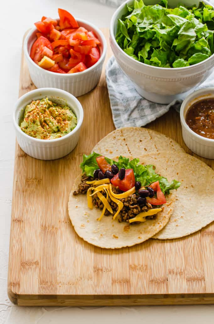 Ground beef taco assembled on a cutting board.