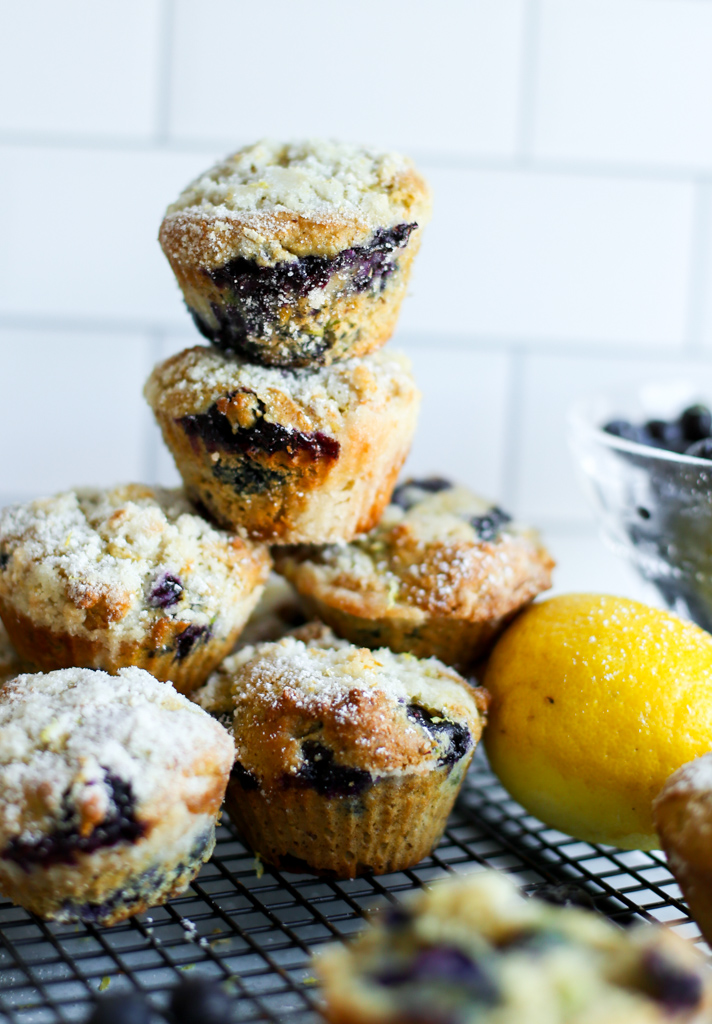Blueberry avocado muffins with a crumb topping stacked up