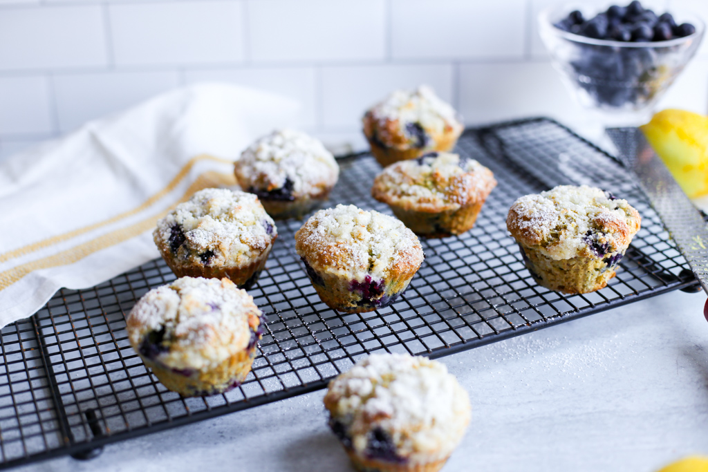 Blueberry avocado muffins cooling on a baking rack