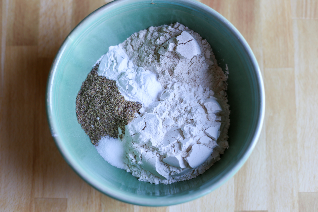 Dry ingredients for healthy blueberry muffin recipe in a bowl.
