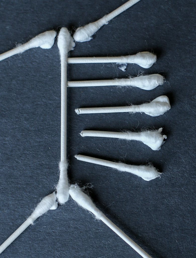 Close up of glue on q-tips