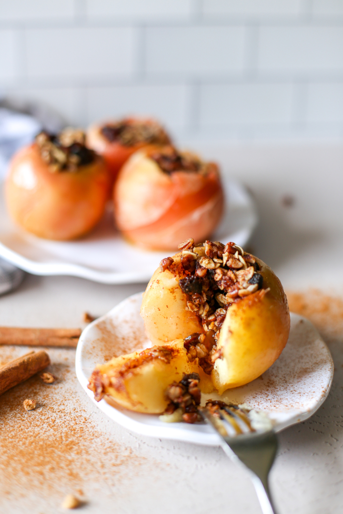 A baked apple sliced open with filling spilling out
