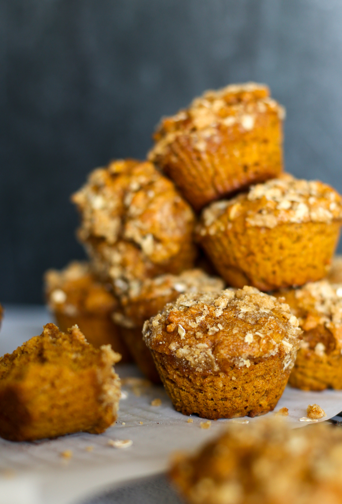 A stack of pumpkin spice muffins with crumble topping