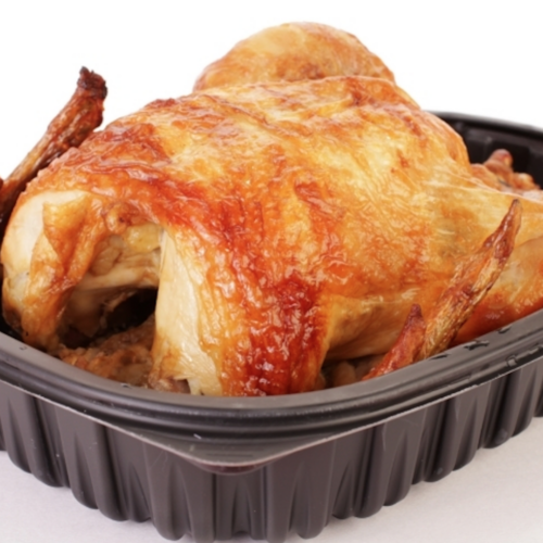 a rotisserie chicken from the store in a black pan