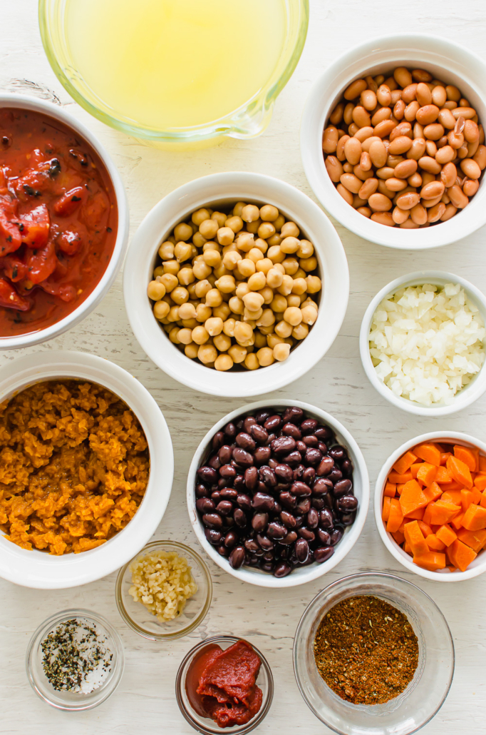 ingredients for vegetarian chili in small bowls on a counter