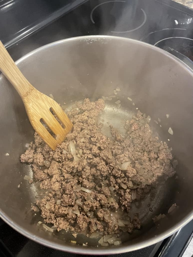 Ground beef for chili being cooked in a pot